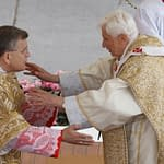 Pope Benedict XVI greets U.S. Cardinal Raymond L. Burke at the sign of peace during Easter Mass in St. Peter's Square at the Vatican April 8. (CNS photo/Paul Haring) (April 9, 2011) See POPE-EASTER April 8, 2011.